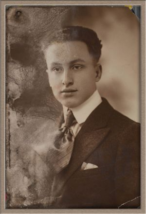 Before Moderate Digital Photo Restoration of Studio Male Portrait