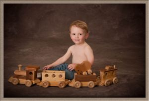 Portrait Photography of Little Boy and Toy Train Set