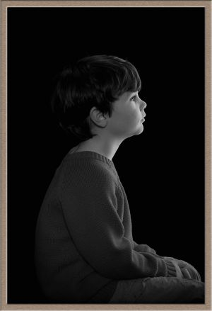 Studio Portrait Photography of Child's Profile in Black-and-White