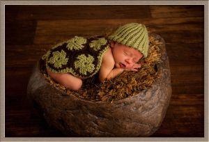 Newborn Boy at Our Family Photography Studio in a Cute Turtle Outfit