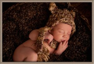 Newborn in a Bear Hat Portrait