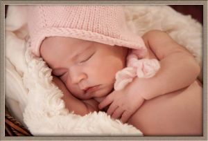 Newborn in a Pink Hat Portrait