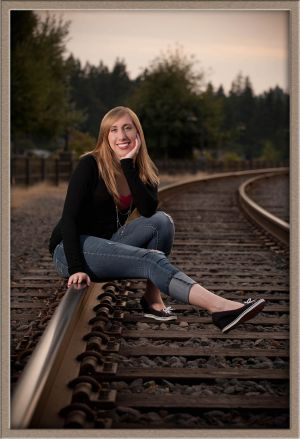 Lakeridge High School Senior Portrait next to Lakewood Bay